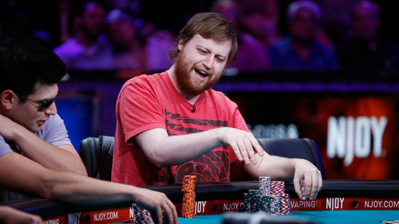 Joseph McKeehen smiles after winning a pot at the World Series of Poker main event Tuesday, July 14, 2015, in Las Vegas.