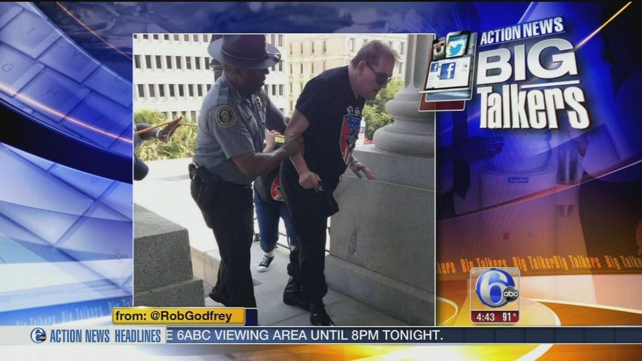 VIDEO: Black cop helps white man wearing swastika shirt during KKK rally