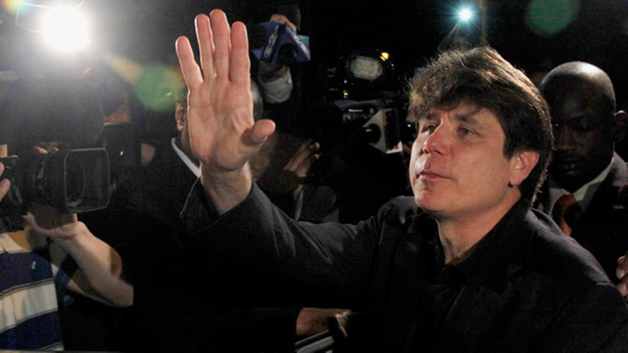 FILE - In this March 15, 2012 file photo, former Illinois Gov. Rod Blagojevich waves as he departs his Chicago home for Littleton, Colo., to begin his 14-year prison sentence.