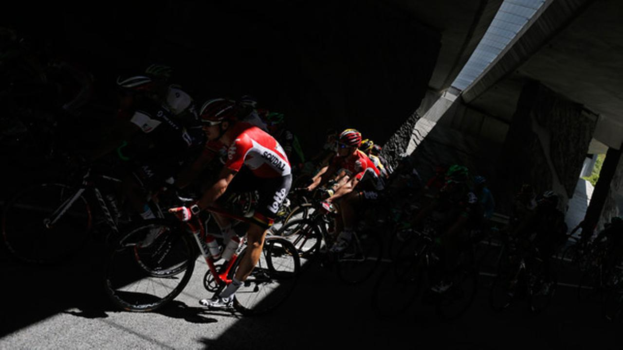 The pack passes through a tunnel during the twentieth stage of the Tour de France cycling race.
