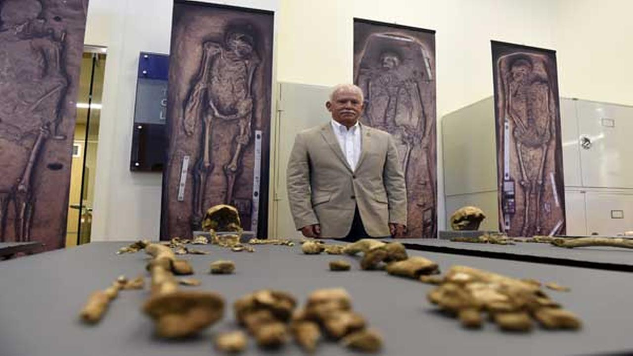 Bill Kelso, director of archaeology at Jamestown Discover, poses with bone fragments of four high-status leaders of the Jamestown colony in Virginia.