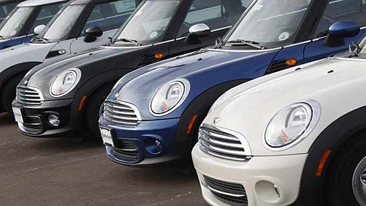 Unsold Mini Coopers sit at a dealership in Littleton, Colorado.
