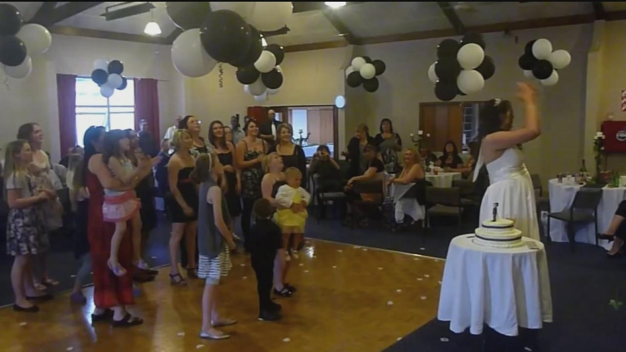 VIDEO: Woman drops baby while reaching for wedding bouquet