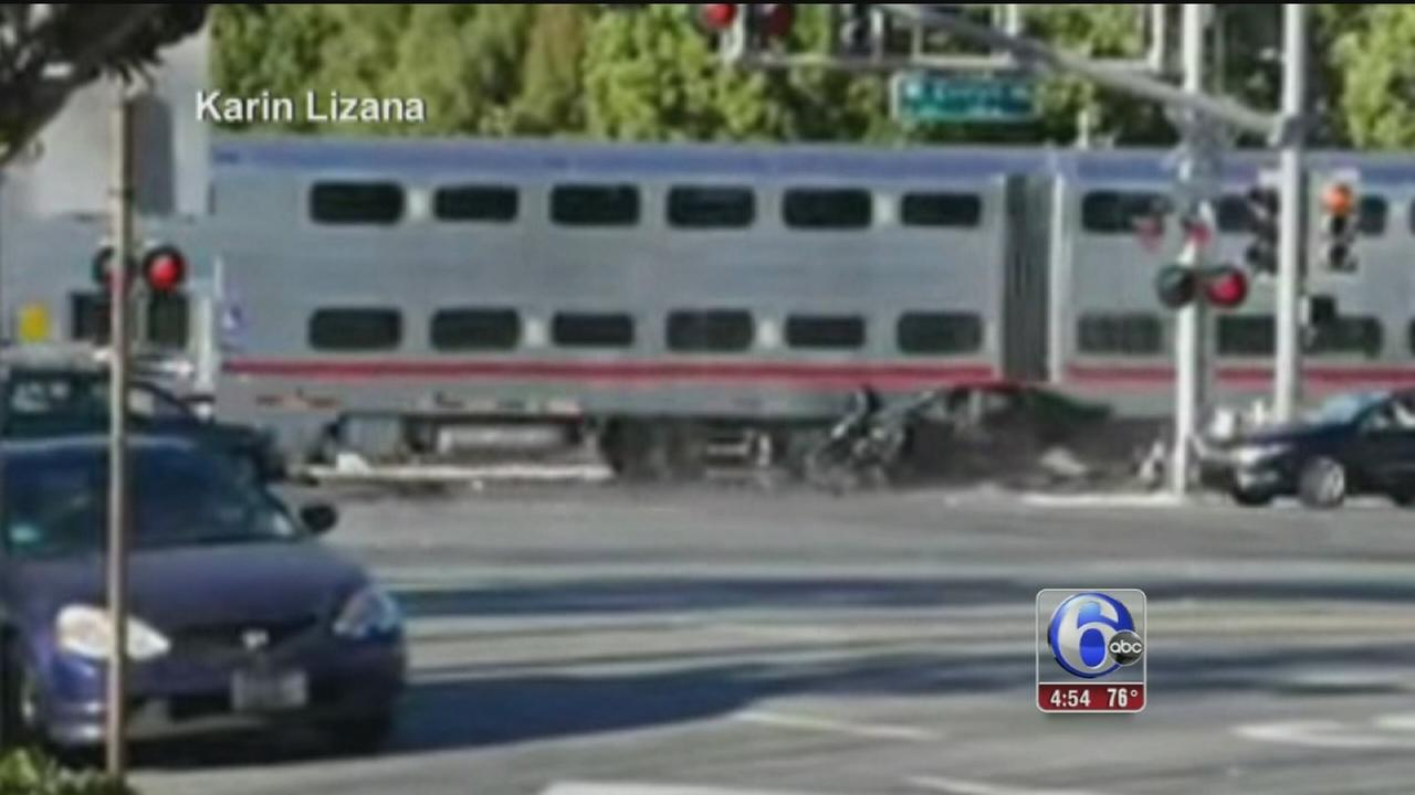 VIDEO: Man rescued from car before train hits