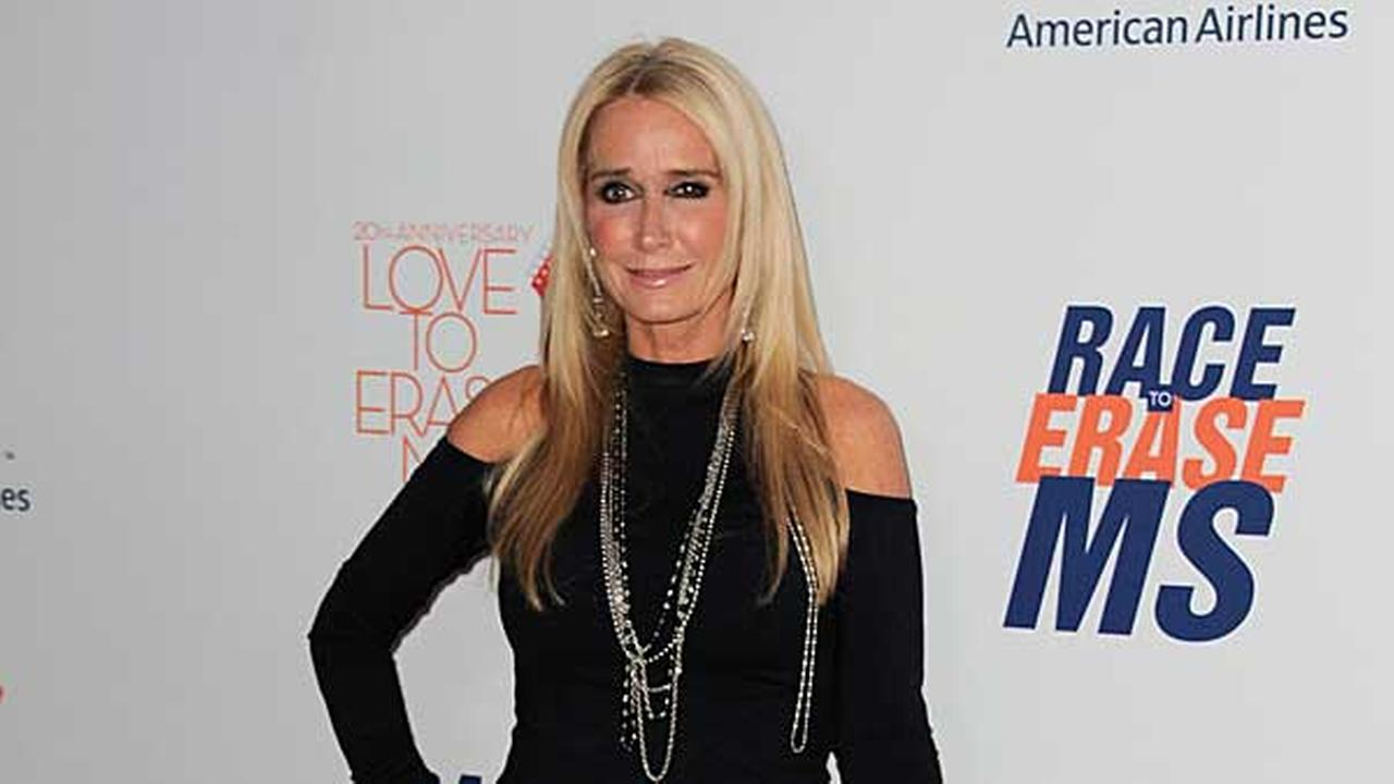 FILE - In this May 3, 2013 file photo, Kim Richards arrives at the 20th annual Race to Erase MS event Love to Erase MS at the Hyatt Regency Century Plaza in Los Angeles.