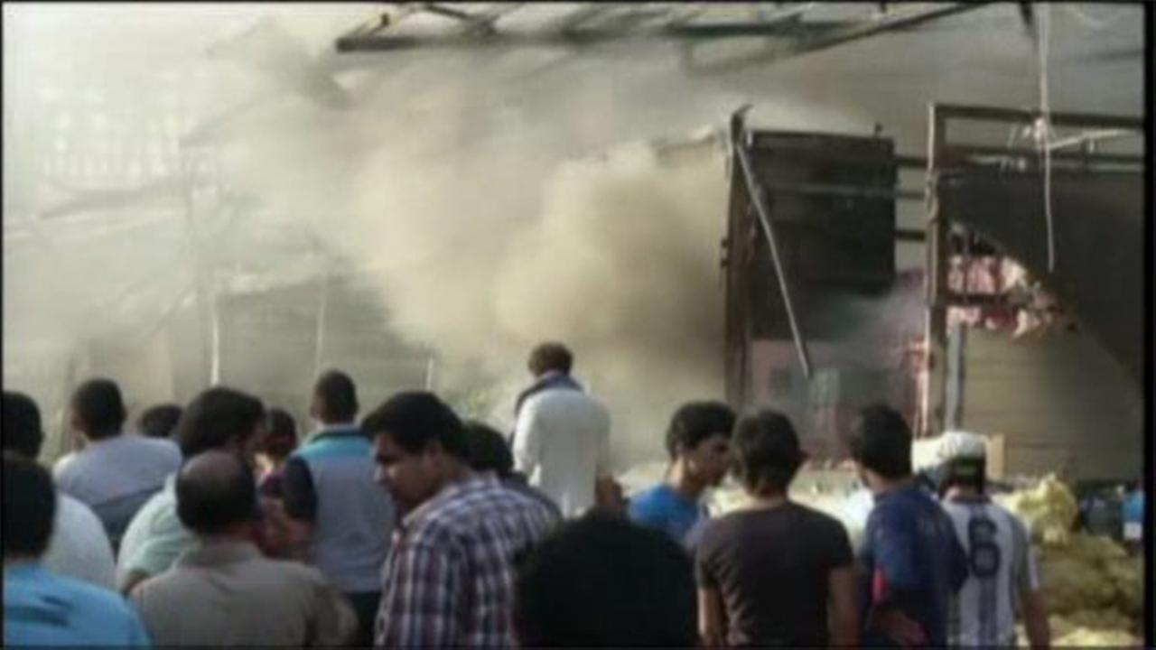 Iraq officials: Huge truck bomb in Baghdad market kills 62
