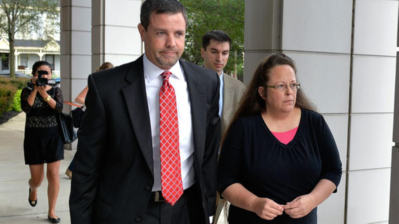 FILE - Rowan County Clerk Kim Davis, right, walks with her attorney Roger Gannam into the United States District Court for the Eastern District of Kentucky in Covington, Ky.