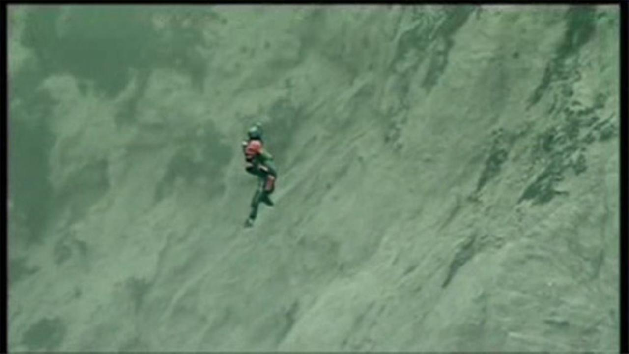 Woman rescued from bottom of cliff