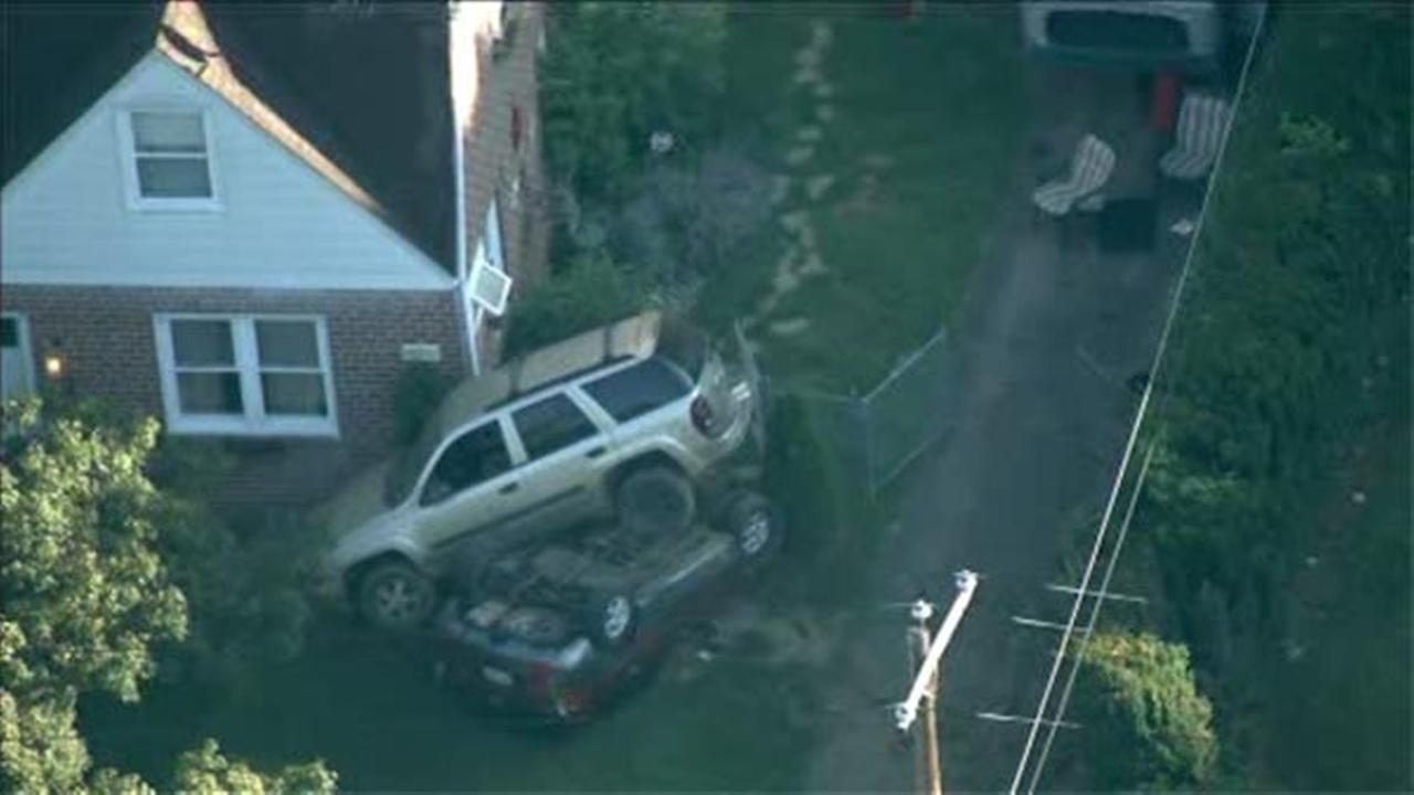 SUVs land on top of each other in Bustleton crash
