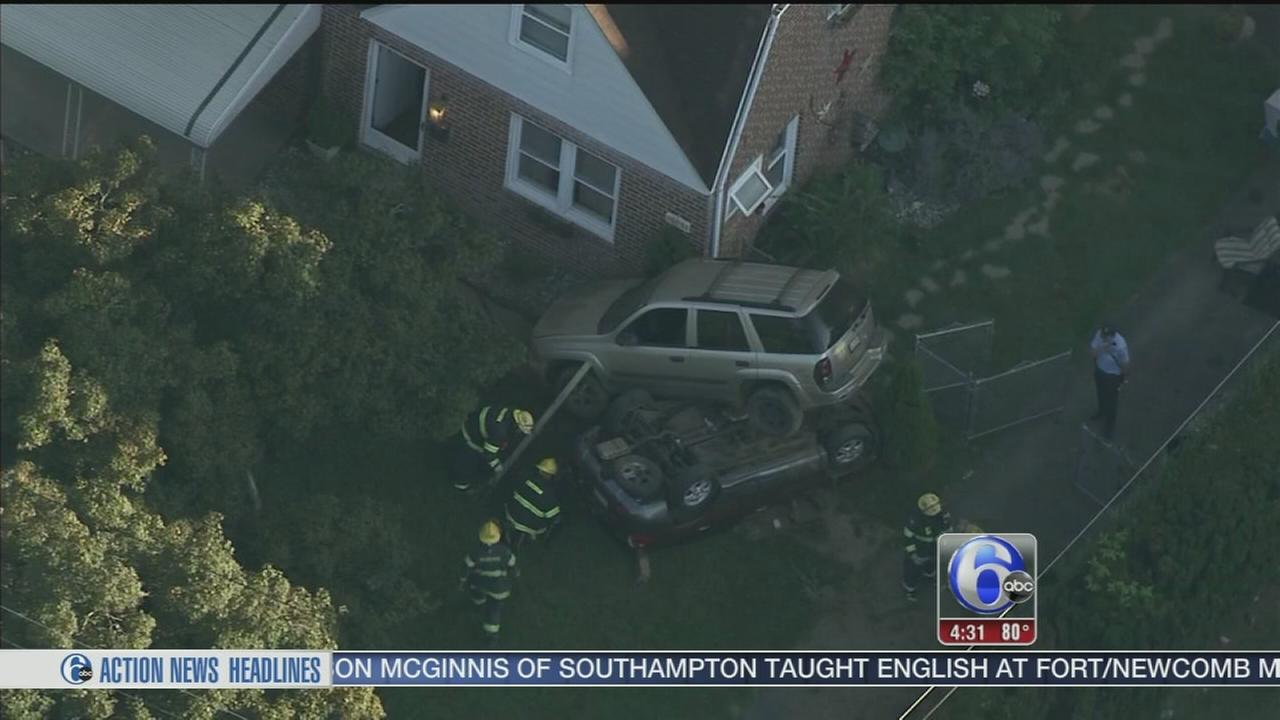 VIDEO: SUV lands on top of overturned SUV in Bustleton crash