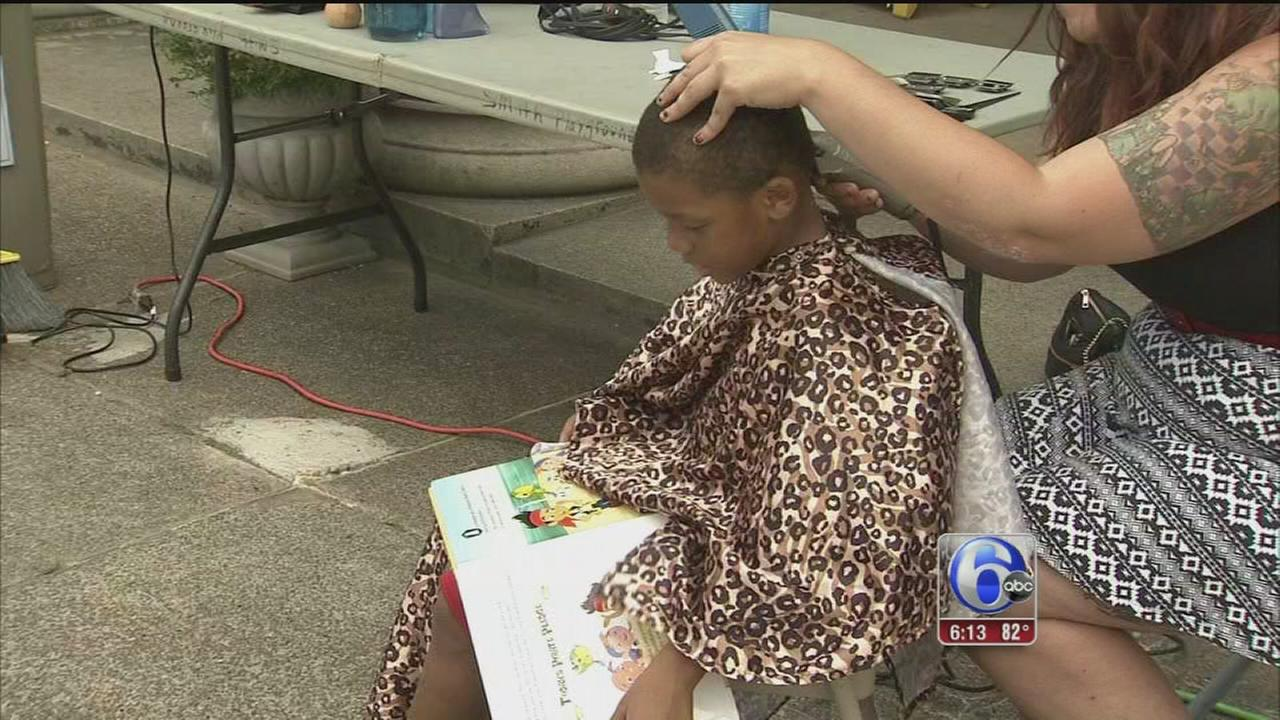 VIDEO: Kids get haircut, free book in E. Fairmount Park