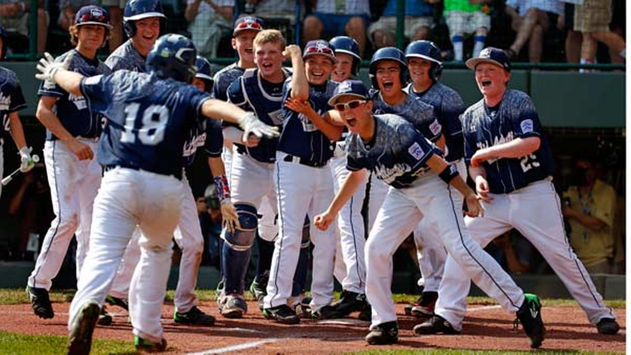 Lewisberry, Pa.s Dylan Rodenhaber (18) runs home to a celebration with teammates after hitting a grand slam.