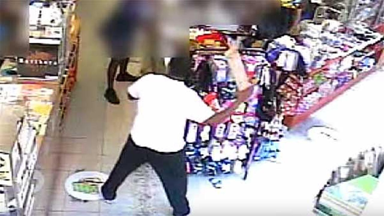Police are looking for a robbery suspect who was caught on surveillance threatening a store clerk with a 2x4 in West Kensington.