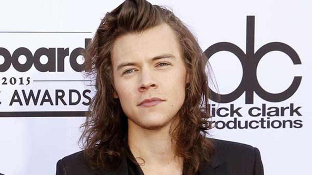 FILE - In this May 17, 2015 file photo, Harry Styles of the musical group One Direction arrives at the Billboard Music Awards in Las Vegas.