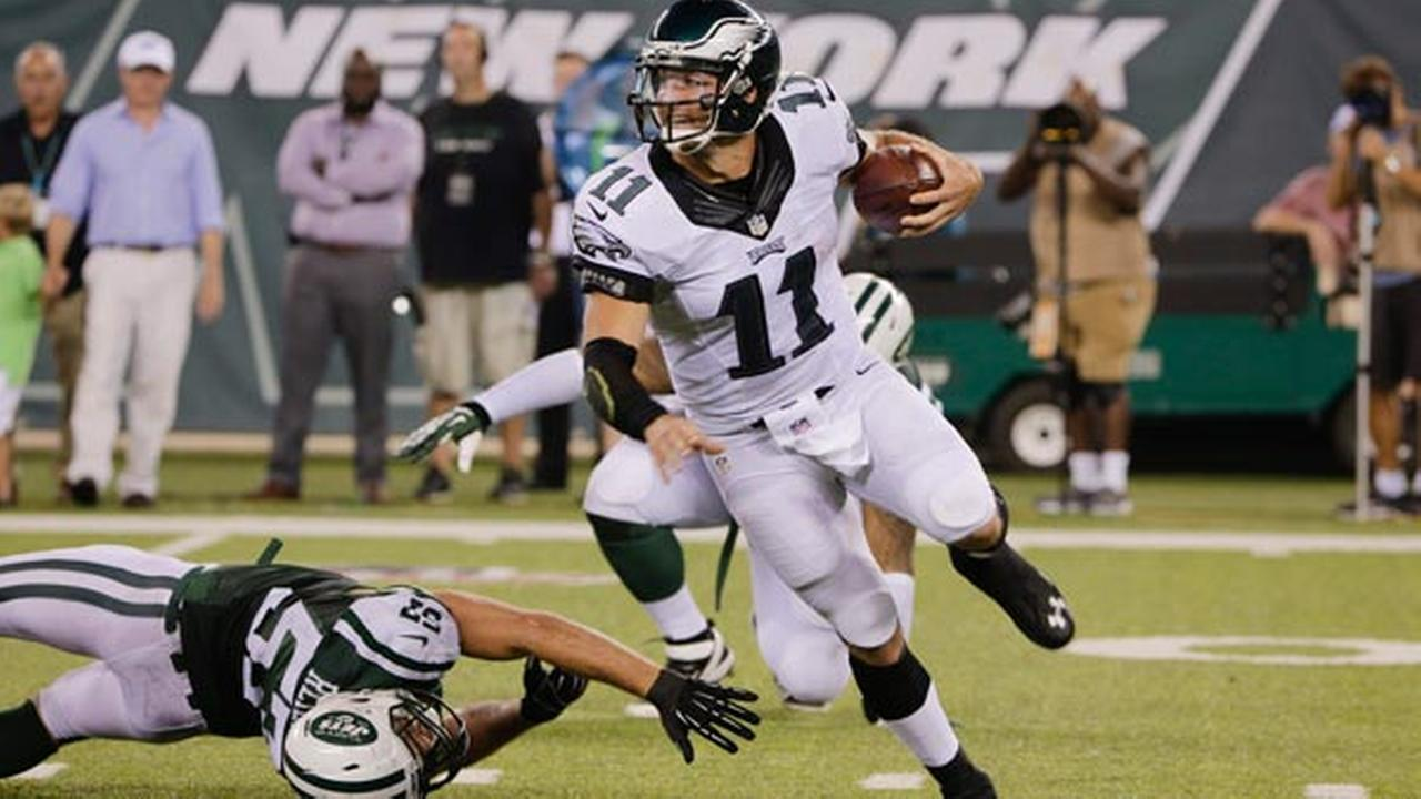 Philadelphia Eagles quarterback Tim Tebow (11) avoids a sack by New York Jets Trevor Reilly.