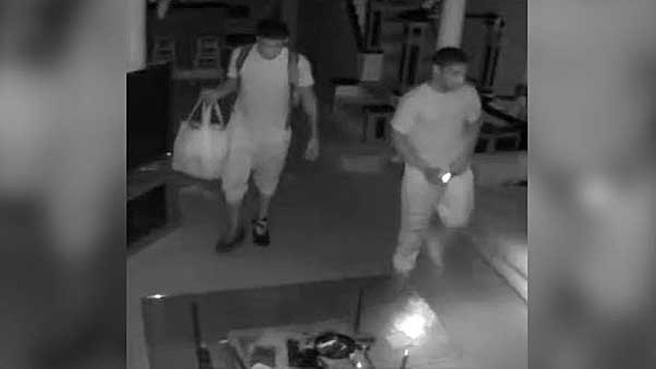 Police are searching for two suspects who were caught on camera burglarizing a home in the South Philadelphias Graduate Hospital section.