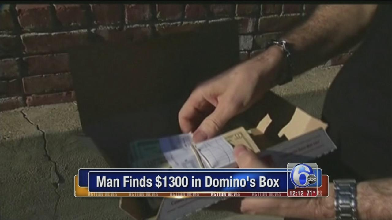 VIDEO: Man finds $1300 in Dominos box