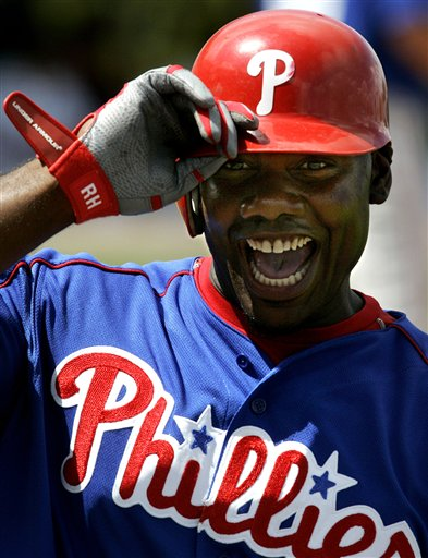 <div class='meta'><div class='origin-logo' data-origin='AP'></div><span class='caption-text' data-credit='AP Photo/Charles Krupa'>Philadelphia Phillies Ryan Howard smiles as he yells to teammates while walking back to the dugout after his second inning solo home run, Tuesday March 14, 2006.</span></div>