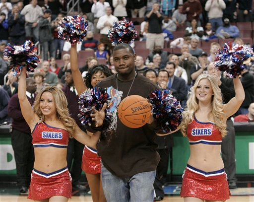 <div class='meta'><div class='origin-logo' data-origin='AP'></div><span class='caption-text' data-credit='AP Photo/George Widman'>Philadelphia Phillies first baseman and National League MVP Ryan Howard is escorted by Philadelphia 76ers cheerleaders, Nov. 21, 2006, in Philadelphia.</span></div>