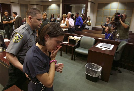 """<div class=""""meta image-caption""""><div class=""""origin-logo origin-image none""""><span>none</span></div><span class=""""caption-text"""">Casey Anthony, foreground, is escorted out of the courtroom, as her parents Cindy and George Anthony, background  center, watch her leave after a bond hearing. (ASSOCIATED PRESS)</span></div>"""