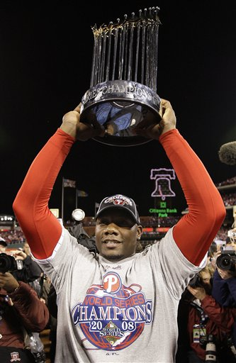 <div class='meta'><div class='origin-logo' data-origin='AP'></div><span class='caption-text' data-credit='AP Photo/David J. Phillip'>Philadelphia Phillies' Ryan Howard holds the World Series trophy after Game 5 of the baseball World Series in Philadelphia, Wednesday, Oct. 29, 2008.</span></div>