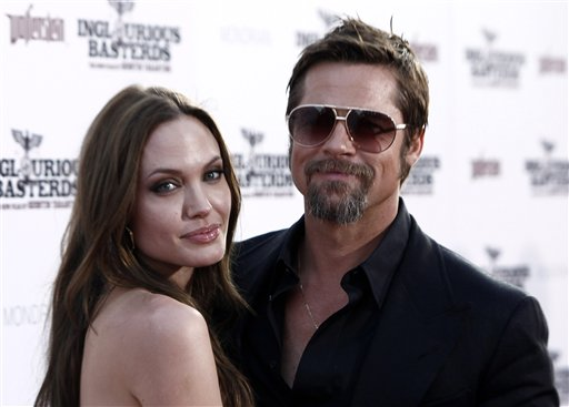 <div class='meta'><div class='origin-logo' data-origin='none'></div><span class='caption-text' data-credit='ASSOCIATED PRESS'>Cast member Brad Pitt, right, and Angelina Jolie arrive at the premiere of &#34;Inglourious Basterds&#34; in Los Angeles on Monday, Aug. 10, 2009.  (AP Photo/Matt Sayles)</span></div>