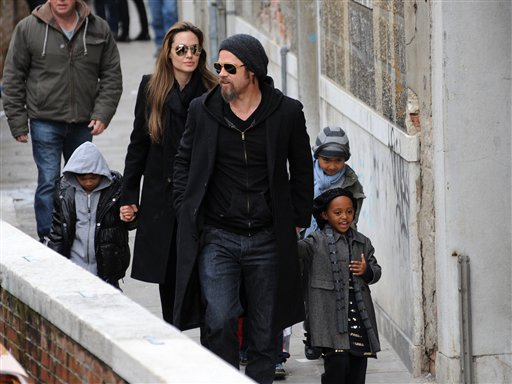 <div class='meta'><div class='origin-logo' data-origin='none'></div><span class='caption-text' data-credit='ASSOCIATED PRESS'>Angelina Jolie and Brad Pitt are seen walking with children Maddox, right, Zahara, front right, and Pax, left, in Venice, Italy, Tuesday, Feb. 16, 2010.(AP Photo/Luigi Costantini)</span></div>