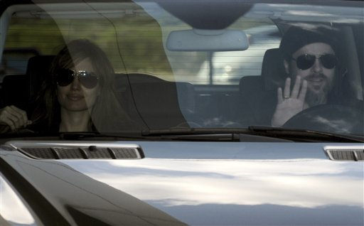 "<div class=""meta image-caption""><div class=""origin-logo origin-image none""><span>none</span></div><span class=""caption-text"">Brad Pitt waves from the car and is accompanied by Angelina Jolie in Montenegrin coastal town of Tivat, Tuesday, April 6, 2010.(AP Photo/Risto Bozovic) (AP)</span></div>"
