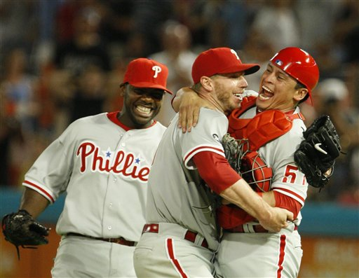<div class='meta'><div class='origin-logo' data-origin='AP'></div><span class='caption-text' data-credit='AP Photo/Wilfredo Lee'>Starting pitcher Roy Halladay, center, celebrates with Carlos Ruiz, right, and Ryan Howard after Halladay threw a perfect game against the Florida Marlins, May 29, 2010</span></div>