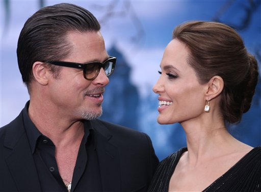 <div class='meta'><div class='origin-logo' data-origin='none'></div><span class='caption-text' data-credit='Photo by Joel Ryan/Invision/AP<br><br>/Invision/AP'>Brad Pitt and Angelina Jolie smile at one another while they pose for photographers in west London, May 8, 2014. (Photo by Joel Ryan/Invision/AP)</span></div>