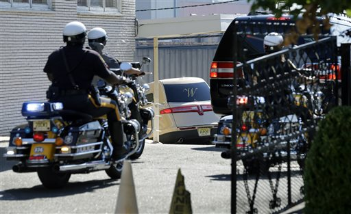 <div class='meta'><div class='origin-logo' data-origin='none'></div><span class='caption-text' data-credit='AP'>A gold colored hearse carrying the coffin bearing the body of Bobbi Kristina Brown arrives with police escort to the back of Whigham Funeral home in Newark, N.J.,</span></div>