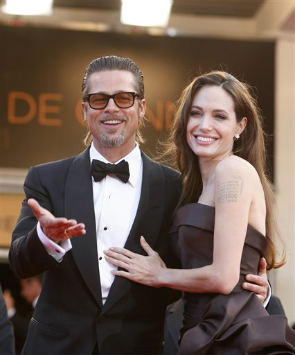<div class='meta'><div class='origin-logo' data-origin='none'></div><span class='caption-text' data-credit='AP'>Brad Pitt and Angelina Jolie arrive for the screening of The Tree of Life at the 64th international film festival, in Cannes, May 16, 2011. (AP Photo/Lionel Cironneau)</span></div>