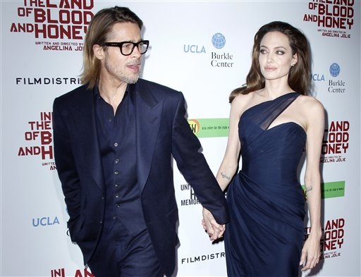 <div class='meta'><div class='origin-logo' data-origin='none'></div><span class='caption-text' data-credit='AP'>Brad Pitt and Angelina Jolie pose at the premiere in Los Angeles, Thursday, Dec. 8, 2011. (AP Photo/Danny Moloshok)</span></div>