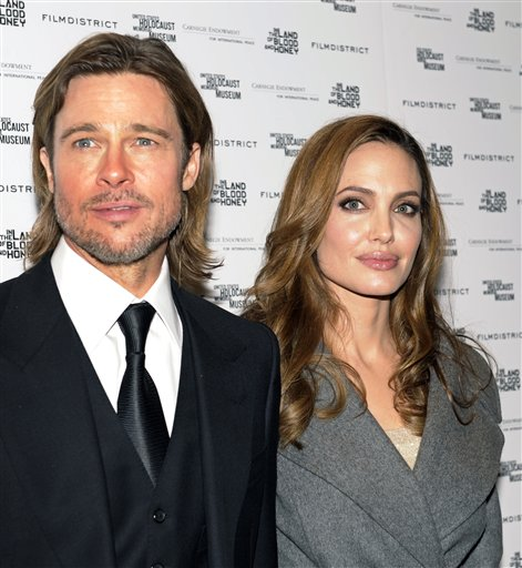 "<div class=""meta image-caption""><div class=""origin-logo origin-image none""><span>none</span></div><span class=""caption-text"">Angelina Jolie and her husband Brad Pitt attend a premier of her movie ""In the Land of Blood and Honey"" Tuesday, Jan. 10, 2012.(AP Photo/Cliff Owen) (AP)</span></div>"