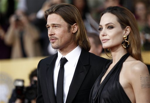 <div class='meta'><div class='origin-logo' data-origin='none'></div><span class='caption-text' data-credit='AP'>Angelina Jolie, right, and Brad Pitt arrive at the 18th Annual Screen Actors Guild Awards on Sunday Jan. 29, 2012 in Los Angeles.    (AP Photo/Matt Sayles)</span></div>