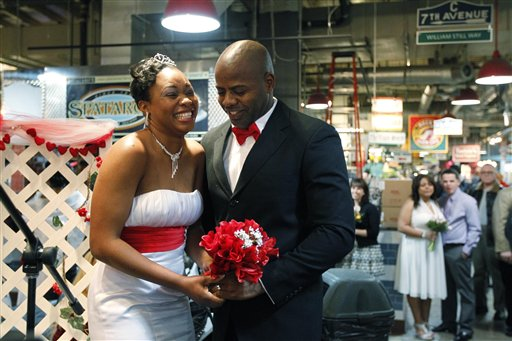 <div class='meta'><div class='origin-logo' data-origin='none'></div><span class='caption-text' data-credit='AP'>Johnson and Latoya Dameon smile after taking their marriage vows on Valentine's Day, at the Reading Terminal Market, Tuesday, Feb. 14, 2012, in Philadelphia. (AP Photo/Matt Rourke)</span></div>
