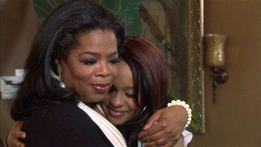 "<div class=""meta image-caption""><div class=""origin-logo origin-image none""><span>none</span></div><span class=""caption-text"">Oprah Winfrey, left, embraces Bobbi Kristina, daughter of the late singer Whitney Houston during an interview in Atlanta, Ga.  (AP Photo/ CL**NY** RJK**NY**)</span></div>"