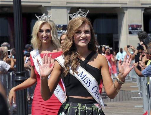 <div class='meta'><div class='origin-logo' data-origin='none'></div><span class='caption-text' data-credit='AP'>Miss Ohio, Alice Magoto waves as she is introduced during Miss America Pageant arrival ceremonies Tuesday, Aug. 30, 2016, in Atlantic City.</span></div>