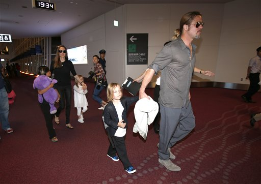 <div class='meta'><div class='origin-logo' data-origin='none'></div><span class='caption-text' data-credit='AP'>Brad Pitt and Angelina Jolie along with their children arrive at Haneda international airport in Tokyo, Sunday, July 28, 2013. (AP Photo/Shizuo Kambayashi)</span></div>