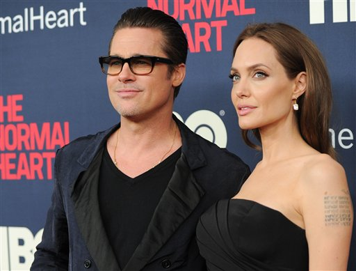 <div class='meta'><div class='origin-logo' data-origin='none'></div><span class='caption-text' data-credit='Evan Agostini/Invision/AP'>Brad Pitt and Angelina Jolie attend the premiere of HBO Films' &#34;The Normal Heart&#34; at the Ziegfeld Theatre on Monday, May 12, 2014, in New York. (Photo by Evan Agostini/Invision/AP)</span></div>