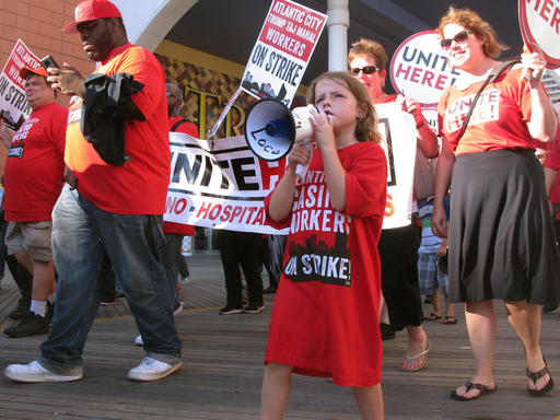 <div class='meta'><div class='origin-logo' data-origin='none'></div><span class='caption-text' data-credit='AP'>Striking union members rally outside the Trump Taj Mahal casino in Atlantic City, N.J.</span></div>