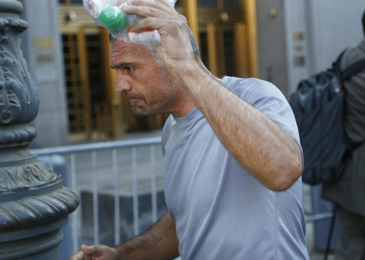 <div class='meta'><div class='origin-logo' data-origin='AP'></div><span class='caption-text' data-credit='ASSOCIATED PRESS'>Anthony Cassetta tries to cover his face as he leaves federal court in New York, Thursday, Aug. 4, 2016.</span></div>