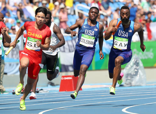 <div class='meta'><div class='origin-logo' data-origin='AP'></div><span class='caption-text' data-credit='AP Photo/Lee Jin-man'>United States' Tyson Gay, right, takes the baton from Christian Coleman, center, as they competes in a men's 4x100-meter relay heat during the 2016 Summer Olympics.</span></div>