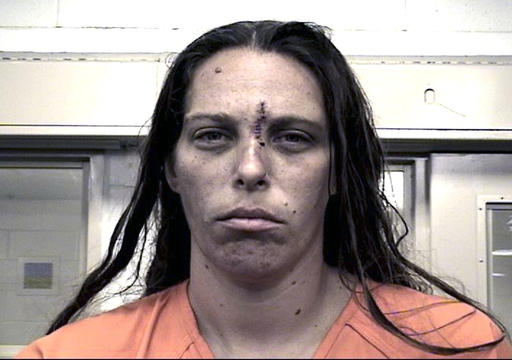 "<div class=""meta image-caption""><div class=""origin-logo origin-image ap""><span>AP</span></div><span class=""caption-text"">This Aug. 25, 2016 booking photo provided by the Metropolitan Detention Center shows Michelle Martens. (Metropolitan Detention Center via AP) (AP)</span></div>"