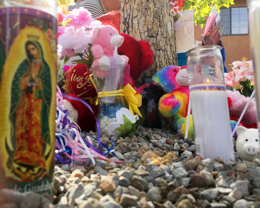 "<div class=""meta image-caption""><div class=""origin-logo origin-image ap""><span>AP</span></div><span class=""caption-text"">A memorial for a 10-year-old girl who police said was sexually assaulted, strangled then dismembered is seen at an Albuquerque, N.M., apartment building Thursday, Aug. 25, 2016. (AP)</span></div>"