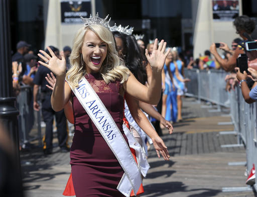 <div class='meta'><div class='origin-logo' data-origin='none'></div><span class='caption-text' data-credit='AP'>Miss Arkansas, Savvy Shields waves during Miss America Pageant arrival ceremonies Tuesday, Aug. 30, 2016, in Atlantic City.</span></div>