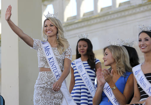 <div class='meta'><div class='origin-logo' data-origin='none'></div><span class='caption-text' data-credit='AP'>Miss Kentucky, Laura Jones waves as she is introduced during Miss America Pageant arrival ceremonies Tuesday, Aug. 30, 2016, in Atlantic City.</span></div>