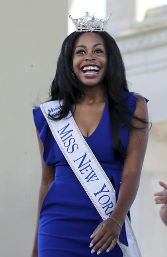 <div class='meta'><div class='origin-logo' data-origin='none'></div><span class='caption-text' data-credit='AP'>Miss New York, Camille Sims smiles as she is introduced during Miss America Pageant arrival ceremonies Tuesday, Aug. 30, 2016, in Atlantic City.</span></div>