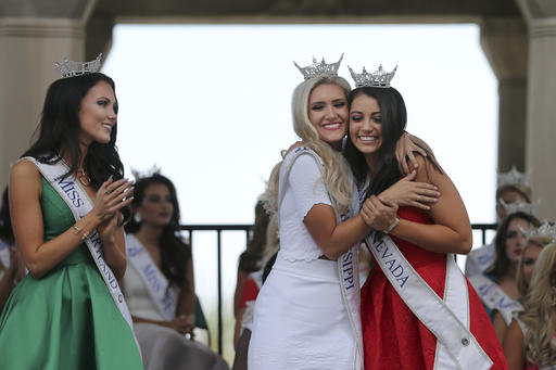 <div class='meta'><div class='origin-logo' data-origin='none'></div><span class='caption-text' data-credit='AP'>Miss Maryland, Hannah Brewer, left, looks on as Miss Mississippi, Laura Lee Lewis and Miss Nevada, Bailey Gumm hug during arrival cerem</span></div>
