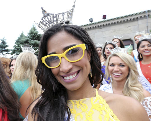 <div class='meta'><div class='origin-logo' data-origin='none'></div><span class='caption-text' data-credit='AP'>Miss Puerto Rico Carole Rigualis wears bright yellow sunglasses during Miss America Pageant arrival ceremonies Tuesday, Aug. 30, 2016, in Atlantic City.</span></div>